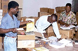 Sabre-donated books being sorted, stamped and packed by Sabre's partner organization, CREDO, in Monrovia, Liberia.